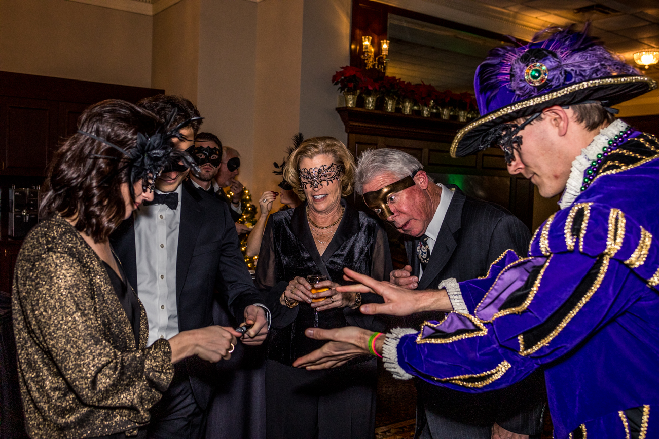 MasquerAID, a fundraising event benefitting the non-profit Infinite Chance, was held on the evening of December 7, 2019. Masked attendees put on masks and donned cocktail attire before arriving at the Manor House in Mason for live music, refreshments, live entertainment by Cincinnati Circus, and multiple auctions. The event raised money to help fund the non-profit's Trade Center project, which plans to teach at-risk Guatemalan youth how to perform various skilled trades so they may go on to work good jobs and earn higher wages. / Image: Catherine Viox // Published: 12.8.19