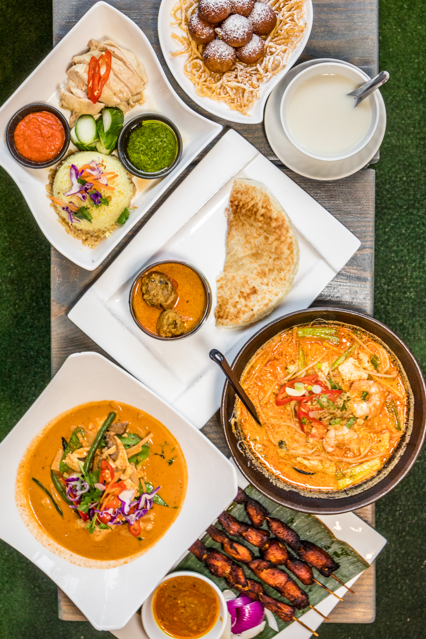 "RESTAURANT: Tea n Bowl / PICTURED: curry laksa noodle soup, Thai red curry, satay chicken, roti canai with curry chicken, Hainanese chicken with garlic butter rice, sweet potato donut and sweet soybean curd soup / ADDRESS: 211 W McMillan Street (Clifton) / PHONE: 513-744-9800 / WEBSITE:{&nbsp;}<a  href=""http://teanbowluc.com/"" target=""_blank"" title=""http://teanbowluc.com/"">teanbowluc.com</a>{&nbsp;}/ Image: Catherine Viox // Published: 11.2.20"
