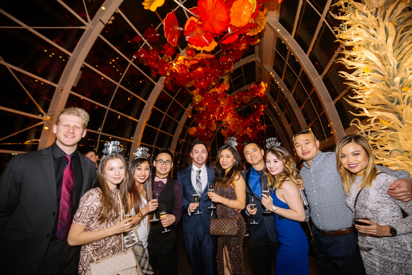 Chihuly Garden and Glass hosts  one of the best New Year's Eve parties in Seattle. The party featured amazing views of the Space Needle's fireworks show, a full dinner, and a live band with a rocking dance floor. (Image: Joshua Lewis / Seattle Refined)