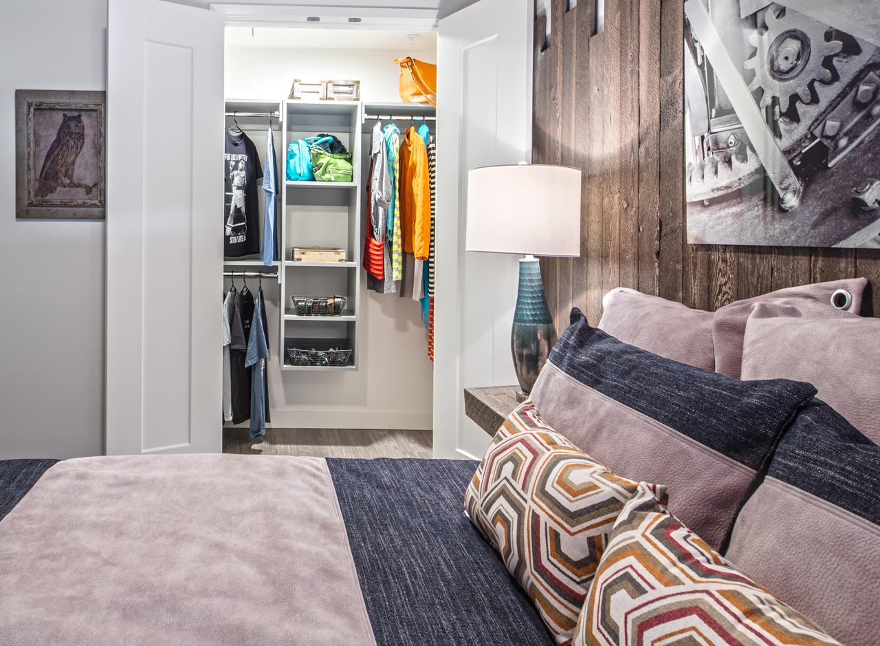 The bedroom of a one bedroom apartment at AMLI Arc