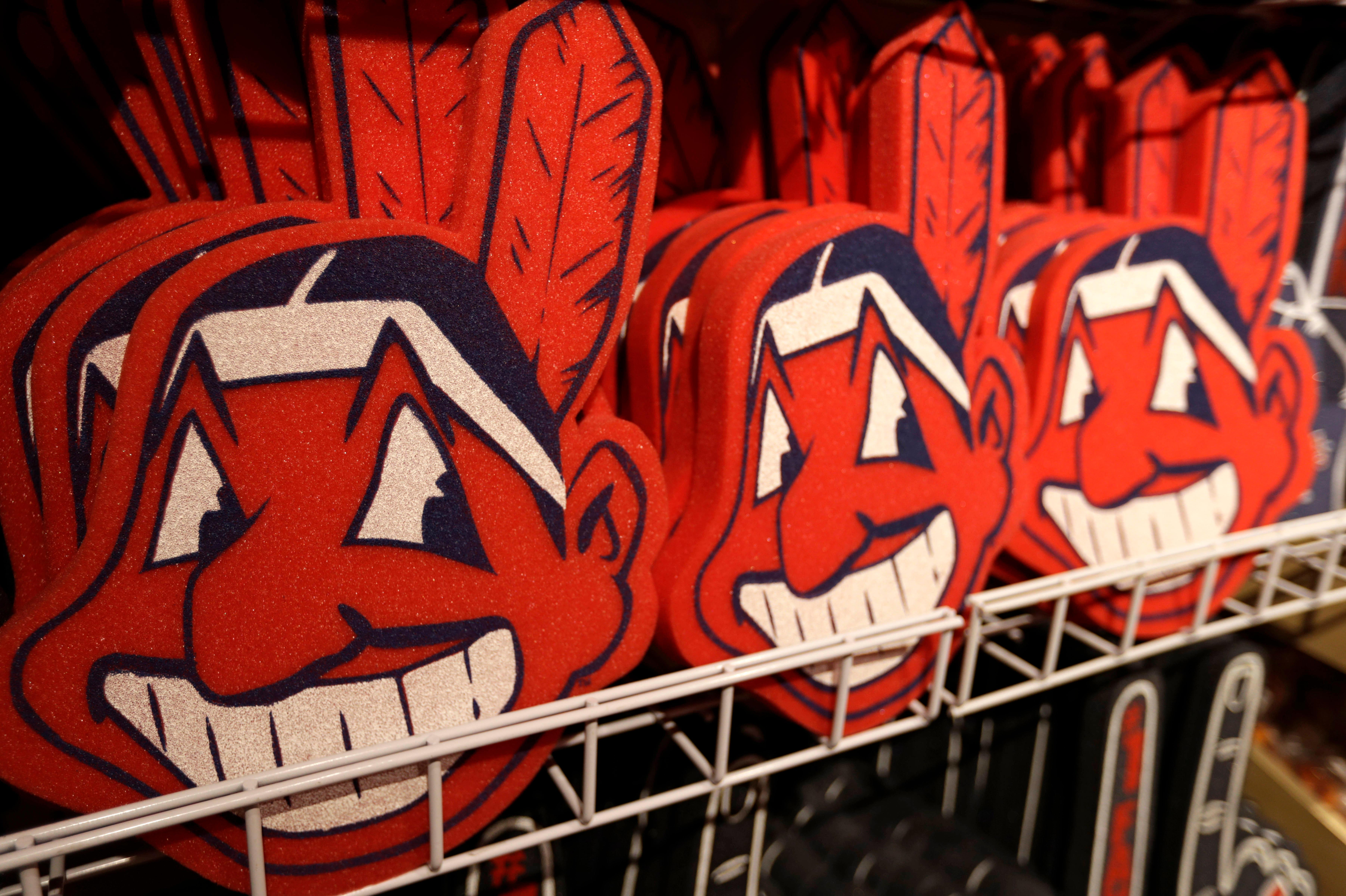 Foam Chief Wahoos line the shelf at the Cleveland Indians team shop, Monday, Jan. 29, 2018, in Cleveland. Divisive and hotly debated, the Chief Wahoo logo is being removed from the Cleveland Indians' uniform next year. The polarizing mascot is coming off the team's jersey sleeves and caps starting in the 2019 season. The Club will still sell merchandise featuring the mascot in Northeast Ohio. (AP Photo/Tony Dejak)