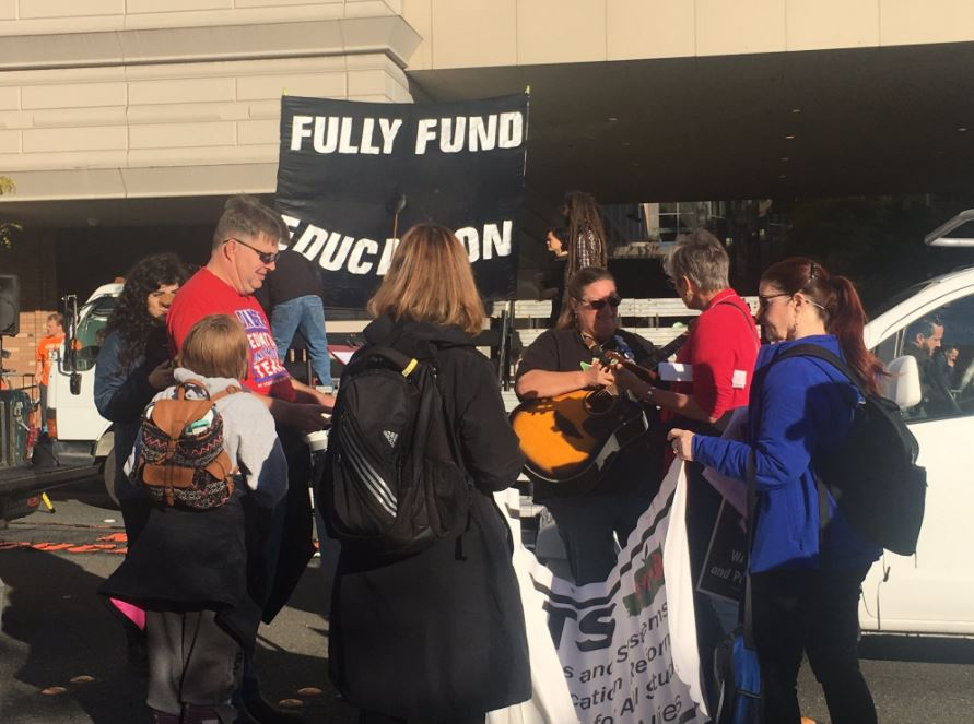 Protesters gather in Bellevue, Wash., to demonstrate against Education Secretary Betsy DeVos on Friday, Oct. 12, 2017. (Photo: KOMO News)