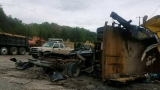Henderson County dump trucks toppled and trashed