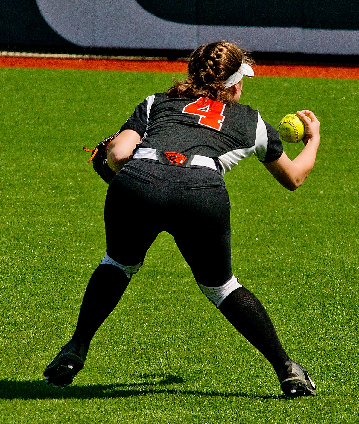 Oregon State Beavers Michelle Sass (#4) bare hands the ball to throw to first. The Oregon Ducks defeated the Oregon State Beavers 7-2 in game two of the three-game Civil War series at Jane Sanders Stadium on Saturday. The final game of the series will be on Sunday at 3:00 p.m. at Jane Sanders Stadium. Photo by Dan Morrison, Oregon News Lab
