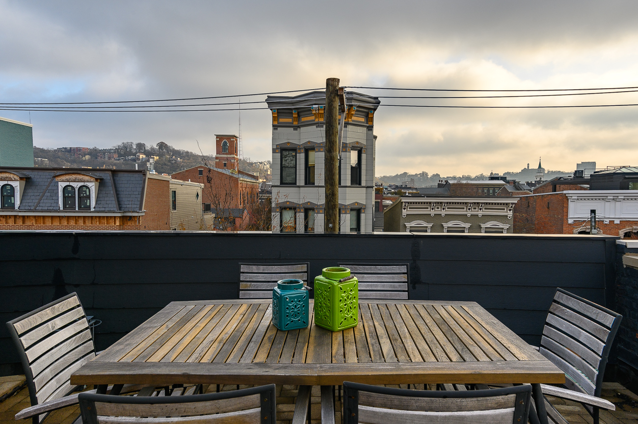 Watching the sun come up over the city with a coffee on the roof? Yes, please. / Image: Phil Armstrong // Published: 12.6.19