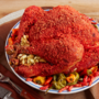 Add a little zest to your Thanksgiving with this Flamin' Hot Cheetos-breaded turkey