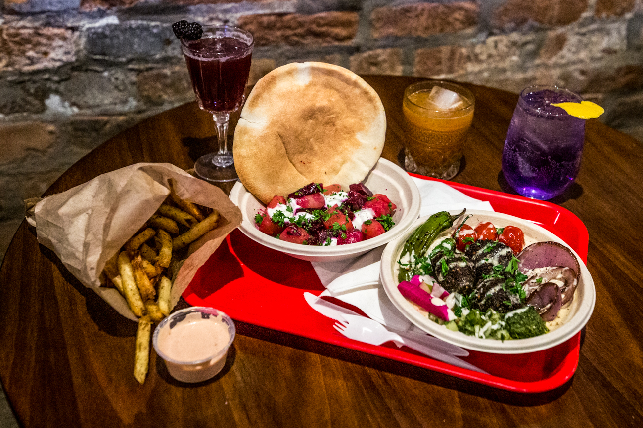 Forty Thieves falafel served over hummus, side of beets, and za'atar fries alongside cocktails: It's Pronounced (Burr-Bun), Violet You're Turning Violet, and the El Camino / Image: Catherine Viox{ }// Published: 11.12.19