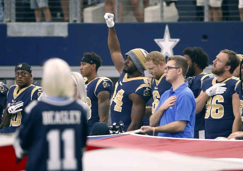 Los Angeles RamsÂ?linebacker Robert Quinn (94) raises his fist during the playing of the national anthemÂ?before the Rams game against the Dallas Cowboys, Sunday, Oct. 1, 2017, at AT&T Stadium in Arlington, Texas. (AP Photo/Ron Jenkins)