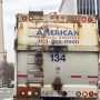 Tired of walking? Raccoon hitches a ride on the back of a trash truck in Virginia