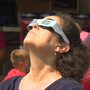Fans watch solar eclipse during Little League World Series game