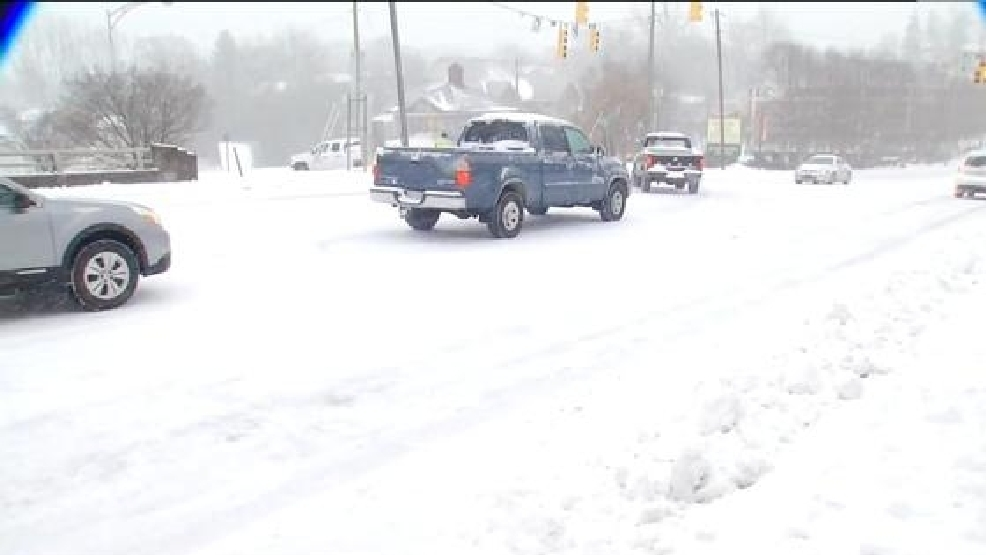 Icy Conditions in Asheville: Braving the Weather on Foot and in Cars