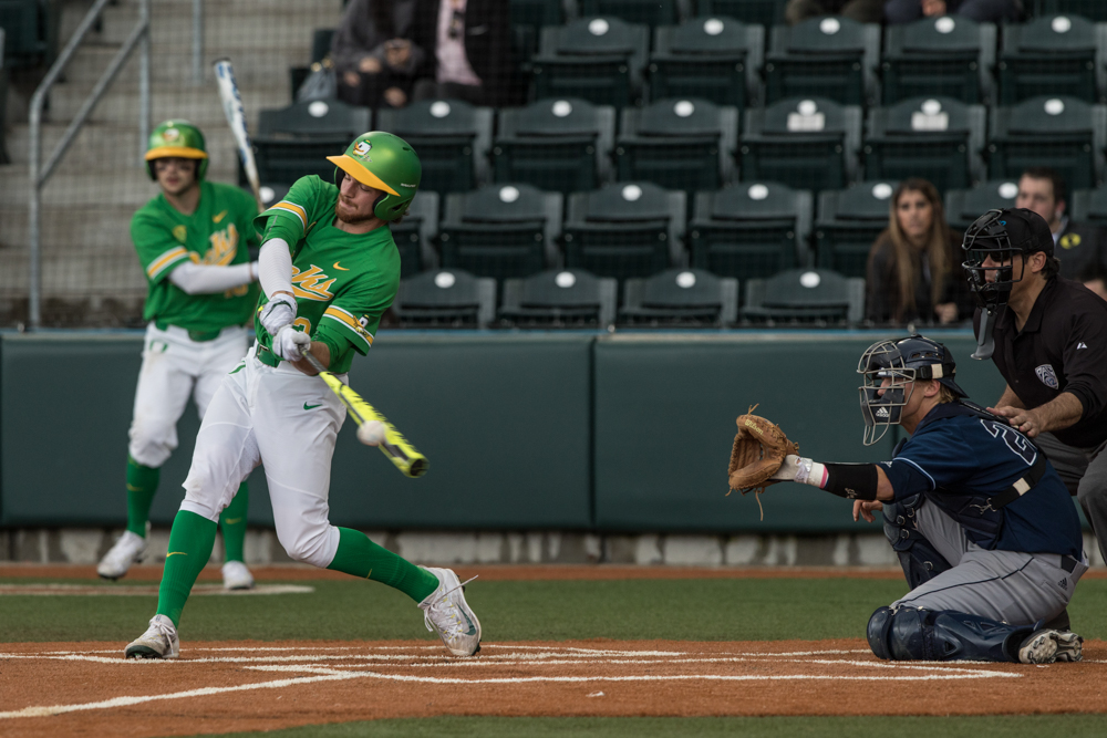Oregon Ducks outfielder Braden Stutzman (#43) hits the ball against the UC Irvine Anteaters. Oregon Ducks pitcher Matt Mercer (#11) throws a pitch.  In the second of the three game series, the Ducks beat the UC Irvine Anteaters 6-3. Photo by Austin Hicks, Oregon News Lab