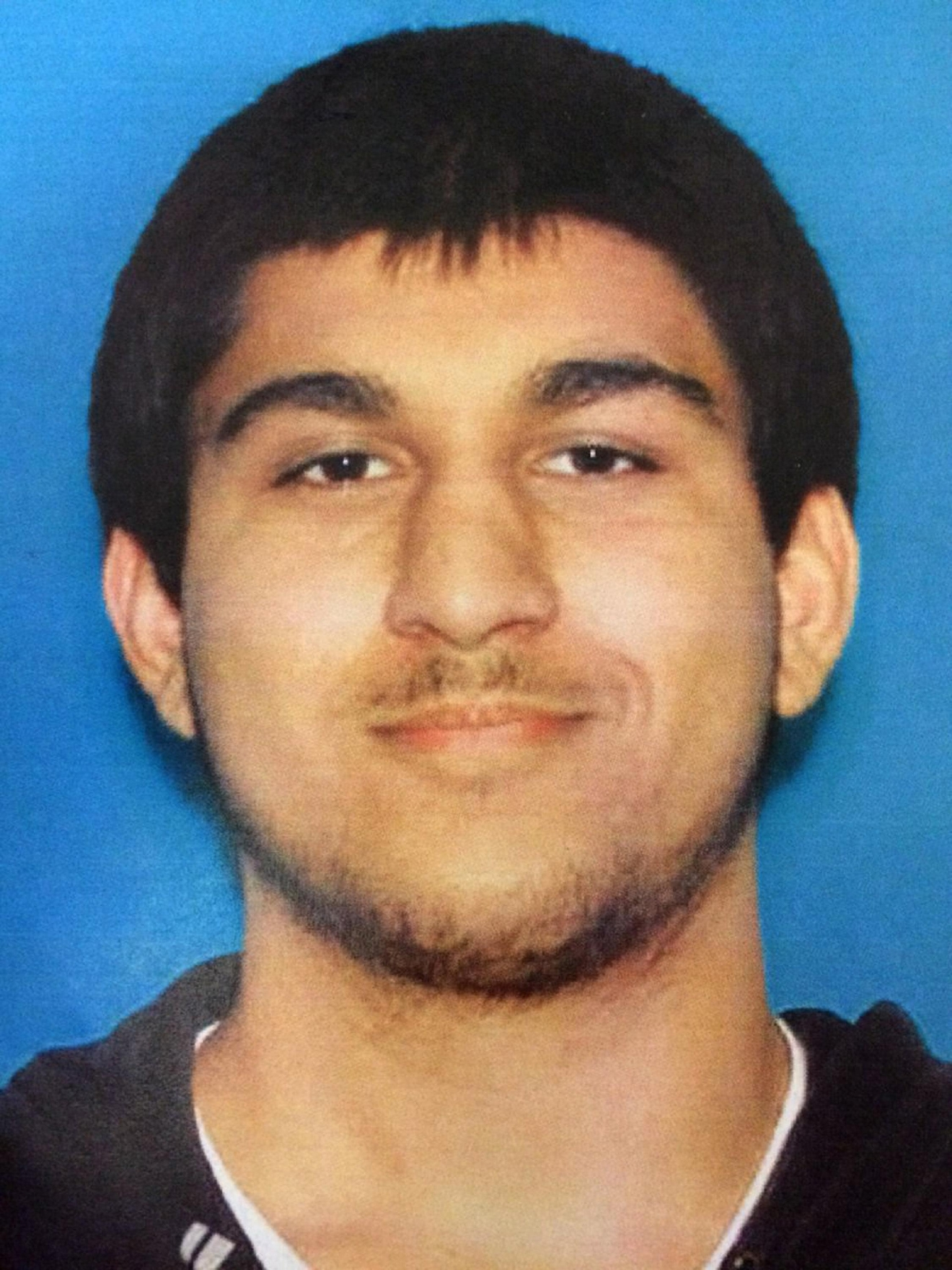 This undated Department of Licensing photo posted Saturday, Sept. 24, 2016, by the Washington State Patrol on its Twitter page shows Arcan Cetin, 20, of Oak Harbor, Wash. Patrol Sgt. Mark Francis Saturday via Twitter identified Cetin as the suspect in a shooting at the Cascade Mall in Burlington, Wash., that left several dead and sparked an intensive, nearly 24-hour manhunt. Authorities say Cetin was apprehended Saturday evening. (Washington State Patrol via AP)