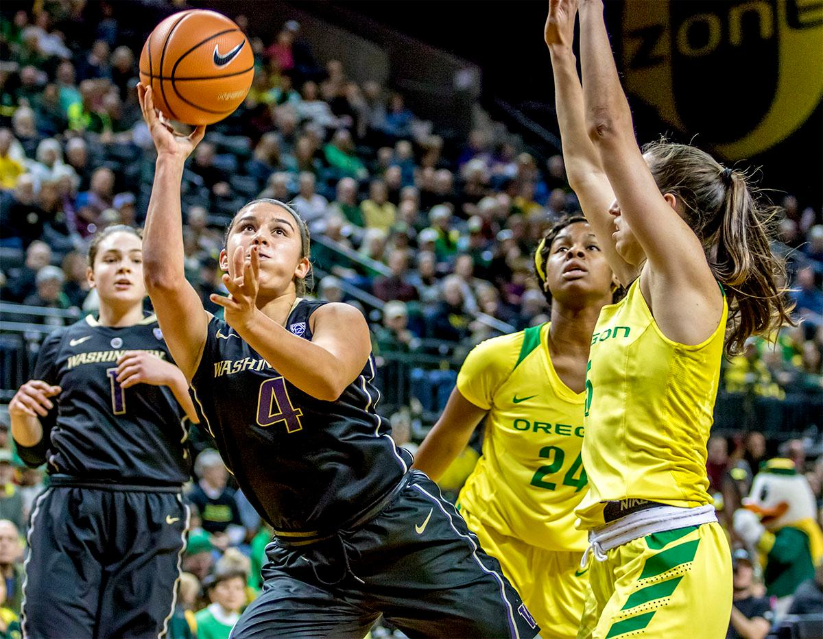 The Huskies' Amber Melgoza (#4) goes for the basket. The Oregon Ducks defeated the Washington Huskies 94-83 on Sunday at Matthew Knight Arena. The victory was Head Coach Kelly Graves' 500th career win. Sabrina Ionescu also set the new NCAA all time record of 8 triple doubles in just 48 games. The previous record was 7 triple doubles in 124 games, held by Susie McConnell at Penn State. The Ducks will next face off against USC on Friday January 5th in Los Angeles. Photo by Rhianna Gelhart, Oregon News Lab