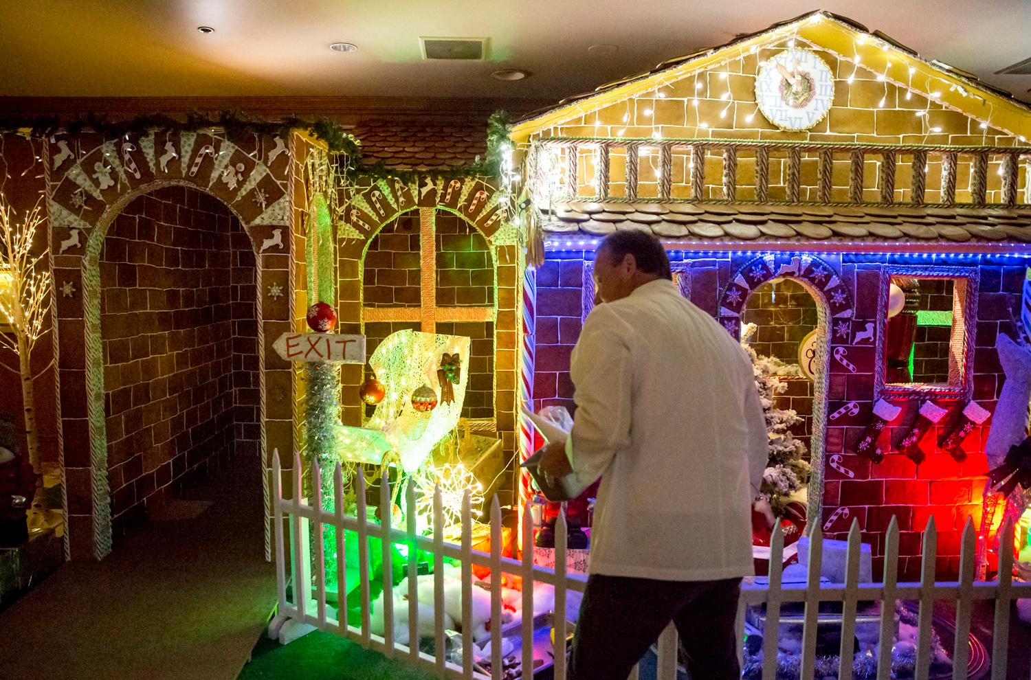 Talk about a dream home! Well - for a person with a sweet tooth that is!The creation of this colossal Gingerbread house has been going on since August and took eight engineers, 15 culinary stars, and hundreds of helping hands. The recipe looks like this: 960 pounds of flour, 20 gallons of milk, 75 gallons of icing, 80 pounds of molasses, 80 pounds of butter, 3 pounds of cinnamon, 3 pounds of nutmeg, 170 pounds of brown sugar, 3 pounds of anise, and 3 pounds of clove! Phew. It gets better... The finished product has 4,100 Gingerbread tiles, 2,500 candy canes, 1,000 spearmints, 50 pounds of crushed candy and 144 feet of candy ropes. I think we just got a sugar contact high. If you haven't ventured down there, this gingerbread house in a must-see, folks! (Image: Sy Bean / Seattle Refined).