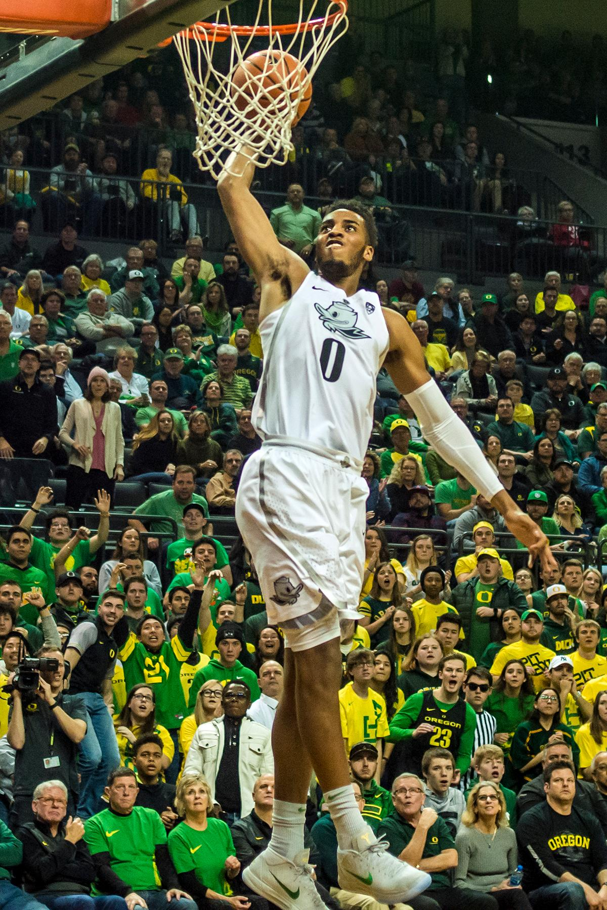 Oregon's Kenny Wooten goes up for a dunk in their matchup against the Arizona Wildcats at Matthew Knight Arena Saturday. The Ducks upset the fourteenth ranked Wildcats 98-93 in a stunning overtime win in front of a packed house of over 12,000 fans for their final home game to improve to a 19-10 (9-7 PAC-12) record on the season. Oregon will finish out regular season play on the road in Washington next week against Washington State on Thursday, then Washington on the following Saturday. (Photo by Colin Houck)