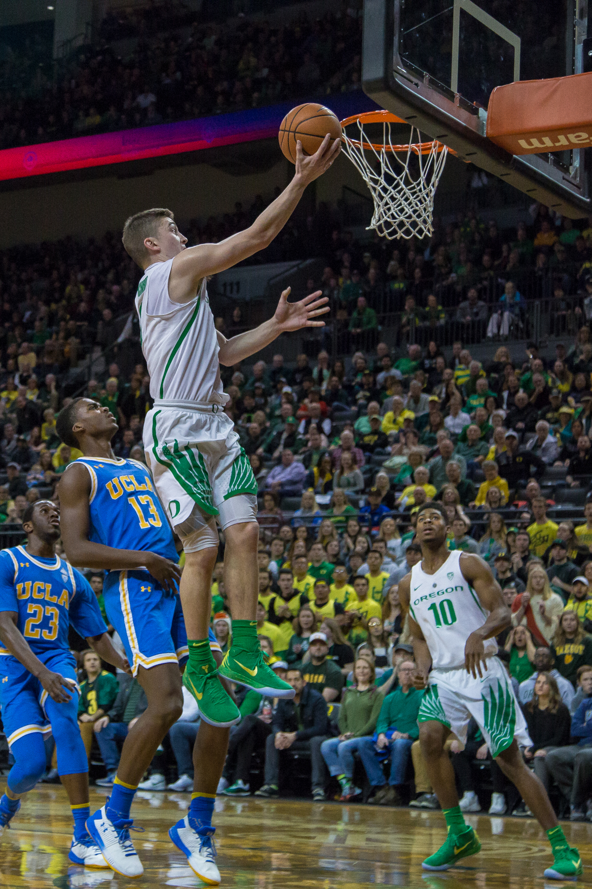 Oregon guard Payton Pritchard (#3) shoots a lay up in the first half. The Oregon Ducks men's basketball team defeated the UCLA Bruins 94-91 Saturday night in front of a home crowd at Matthew Knight Arena. The win brings the Ducks 13-7 overall for the season and 3-4 in Pac-12 play. Photo by Dillon Vibes