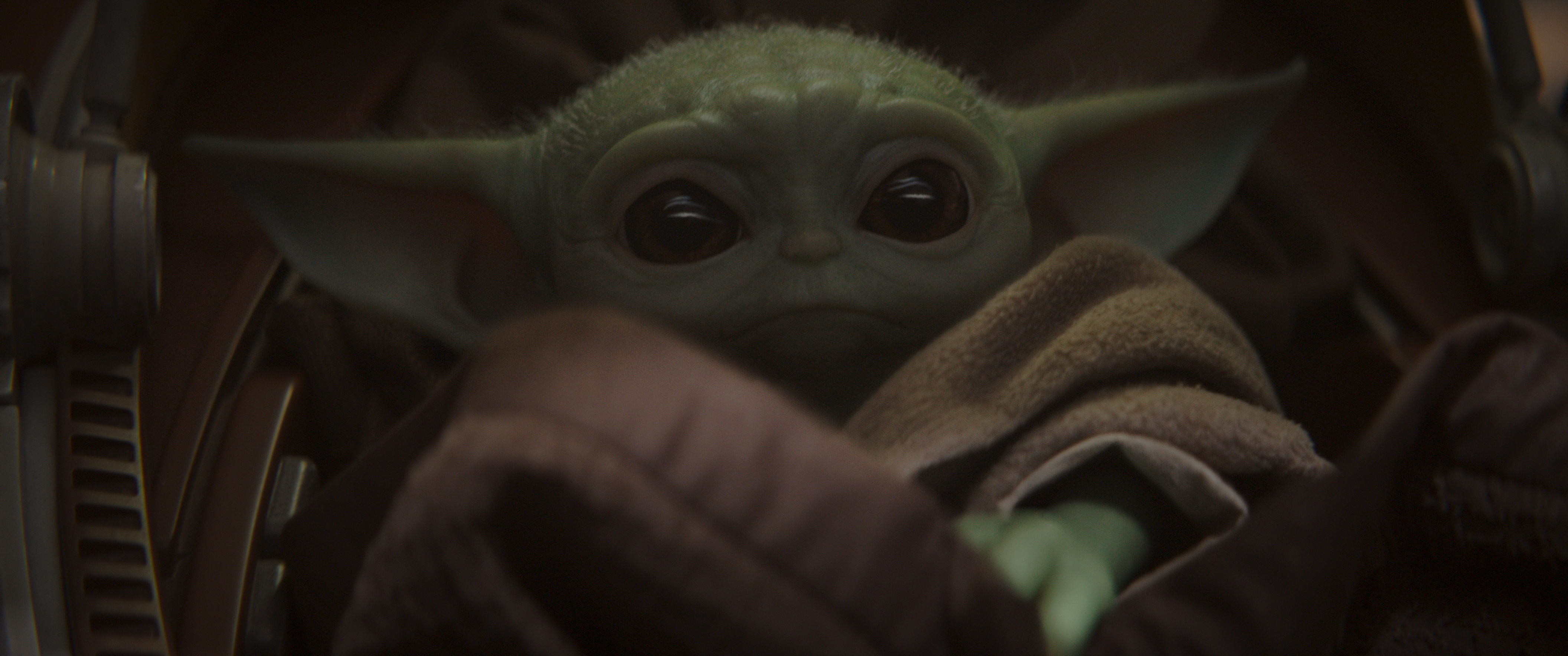 "This undated image provided by Disney Plus shows a scene from ""The Mandalorian."" People can send each other animations of Baby Yoda again. Giphy, a database of the mini-videos, had been removing animated GIF files of the Star Wars character from the new Disney Plus streaming series ""The Mandalorian."" (Disney Plus via AP)"