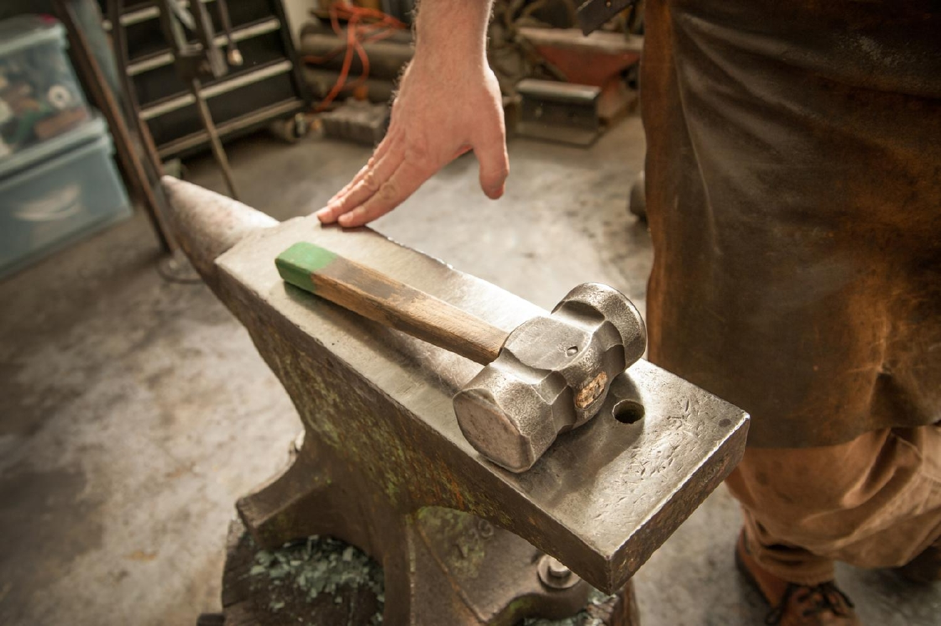 Pictured atop the anvil is the first tool Gilsdorf made while learning the tricks of the trade. It's a 4 lb. rounding hammer, which he uses for most of his work as an artist-blacksmith. / Image: Melissa Doss Sliney