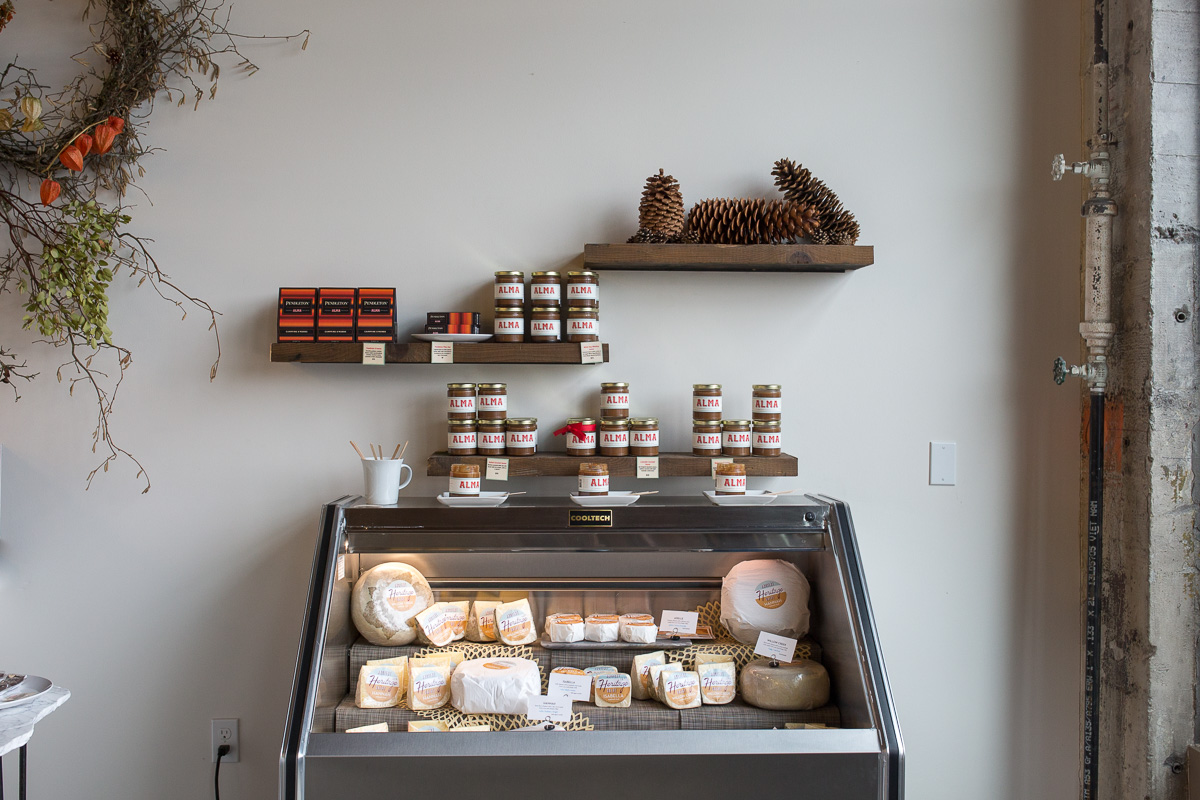 The cheese is available for sale next door at Alma Chocolate, where delectable chocolates, chocolate nut toffees and drinking chocolates are crafted and sold. (Image: Paola Thomas / Seattle Refined)