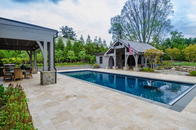 Faneca invested $1 million in backyard design, including a sport spec pool, pool house with guest suite, a covered outdoor kitchen with fans, heating lamps, a fire pit and a Green Egg. (Image: Courtesy HomeVisit)<p></p>
