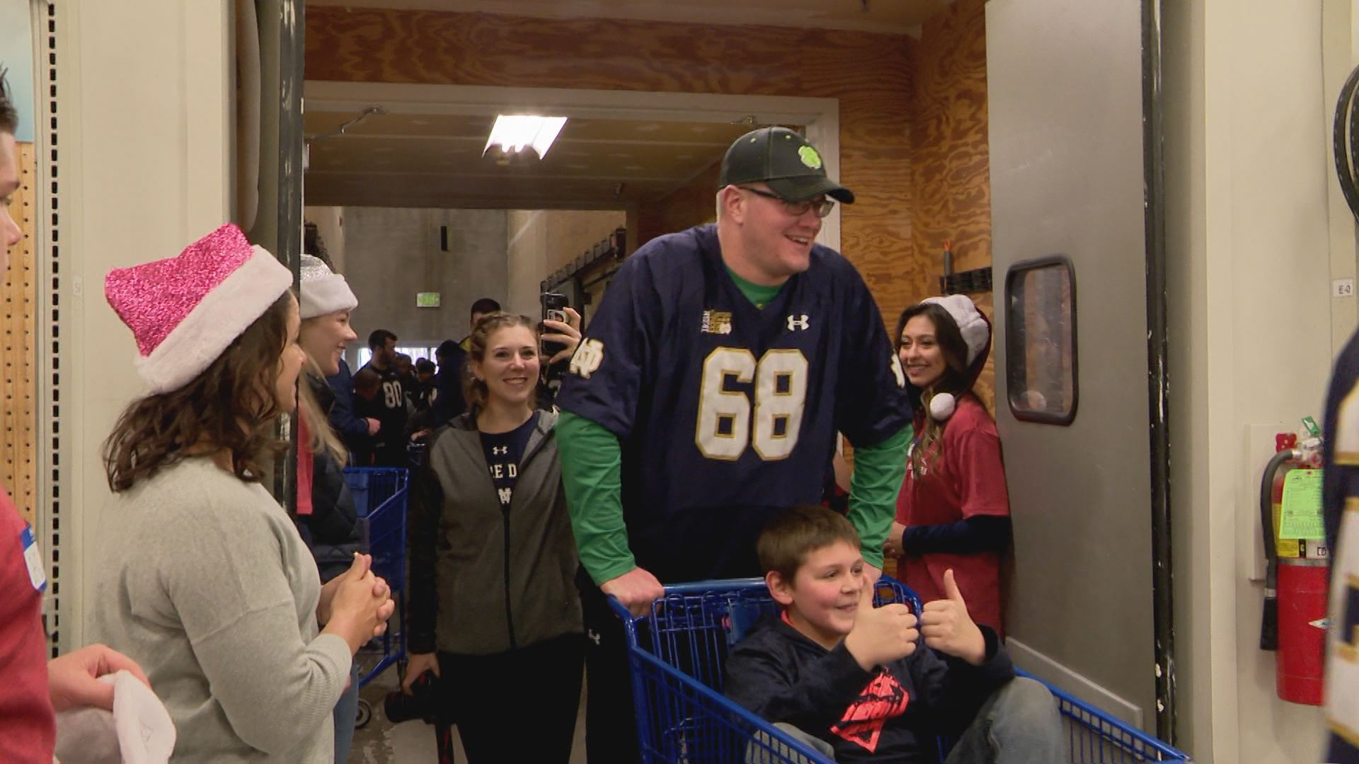 Mike McGlinchey pushes a local boy in a shopping cart as they enter the Meijer shopping spree // WSBT 22 Photo<p></p>