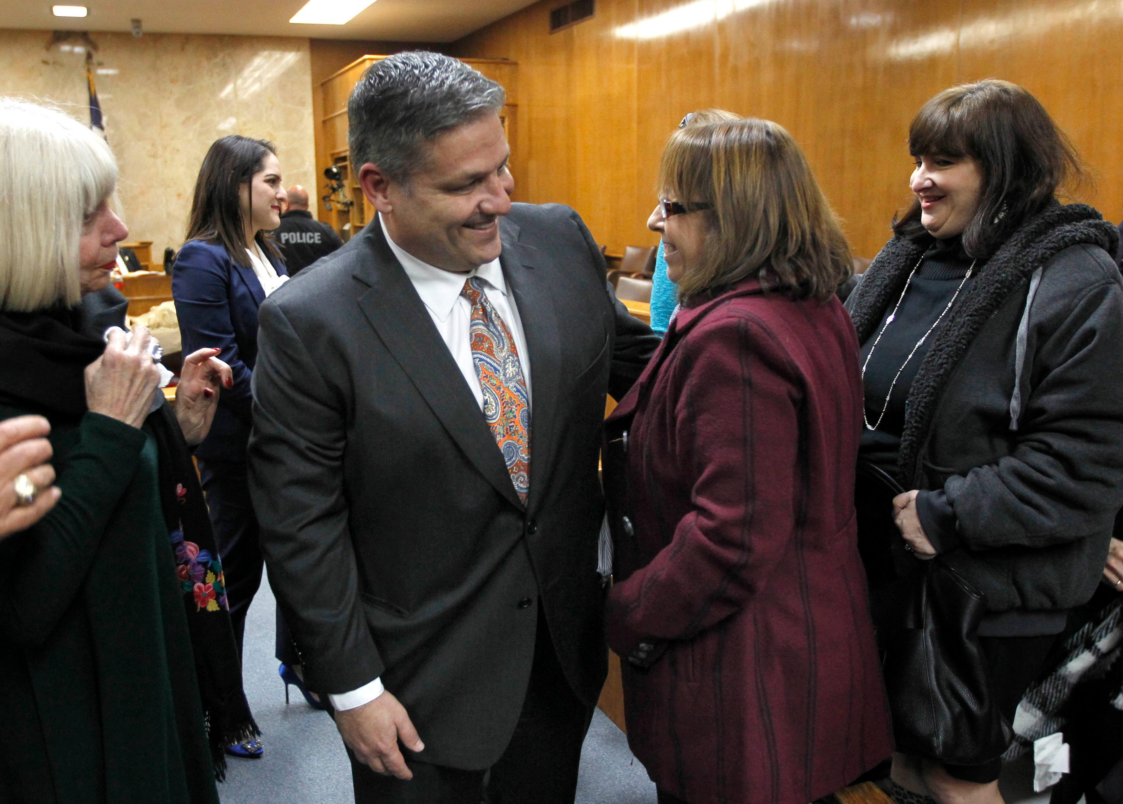 Hidalgo County Assistant District Attorney Michael Garza talks with Lynda de la Vi?a following the guilty verdict in John Bernard Feit's trial for the 1960 murder of Irene Garza in the 92nd state District Court Thursday, December 7, 2017, at the Hidalgo County Courthouse in Edinburg. De la Vi?a is a relative of the Irene Garza.  (Nathan Lambrecht/The Monitor/Pool)