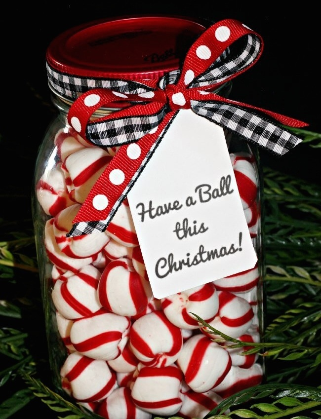 Holiday sweets make a tasty gift when packaged in a cute way, like this Candy in a Mason Jar. (Image: Trish Flake/Uncommon Designs) Link: http://www.uncommondesignsonline.com/have-a-ball-this-christmas-printable-gift-tags/