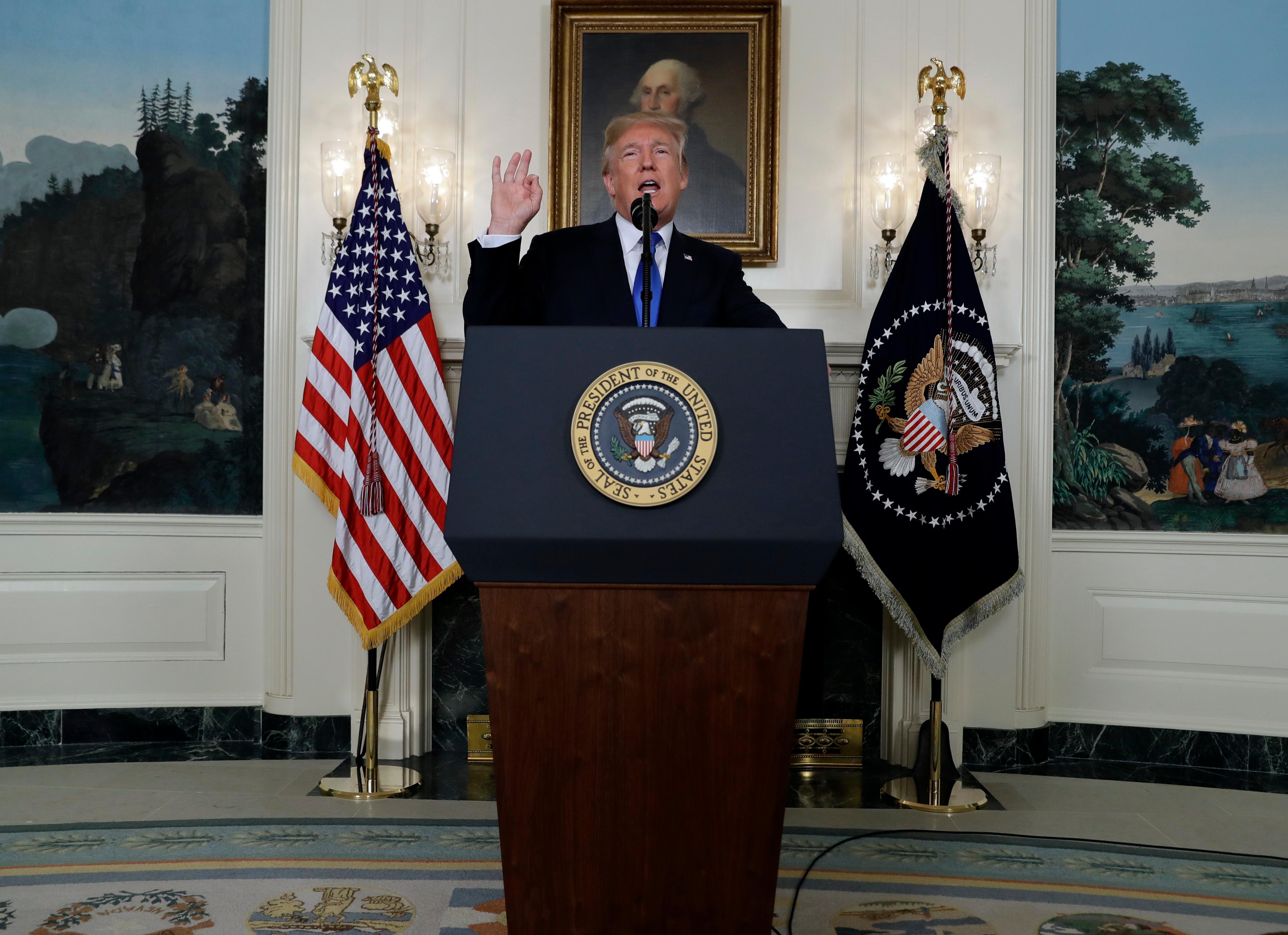President Donald Trump speaks on Iran policy from the Diplomatic Reception Room of the White House, Friday, Oct. 13, 2017, in Washington. (AP Photo/Evan Vucci)