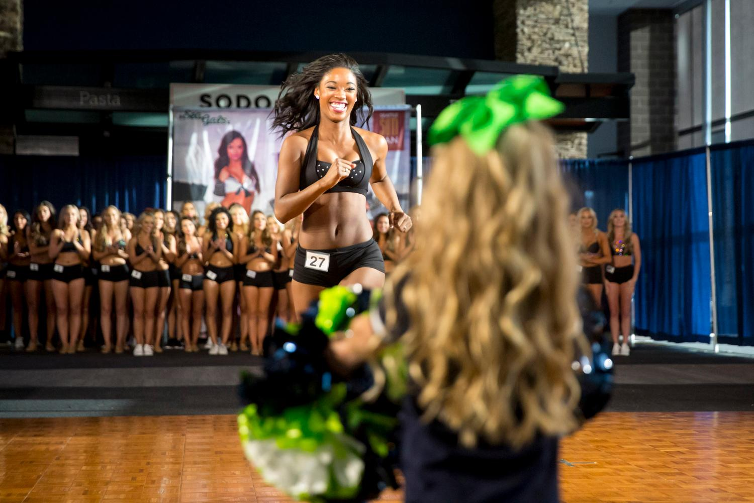 Welcome De'Djauna, a 2018 Sea Gal! Dancers performed a choreographed routine and spoke briefly about themselves. The entire evening was live broadcasted on the Seahawks website. (Sy Bean / Seattle Refined)