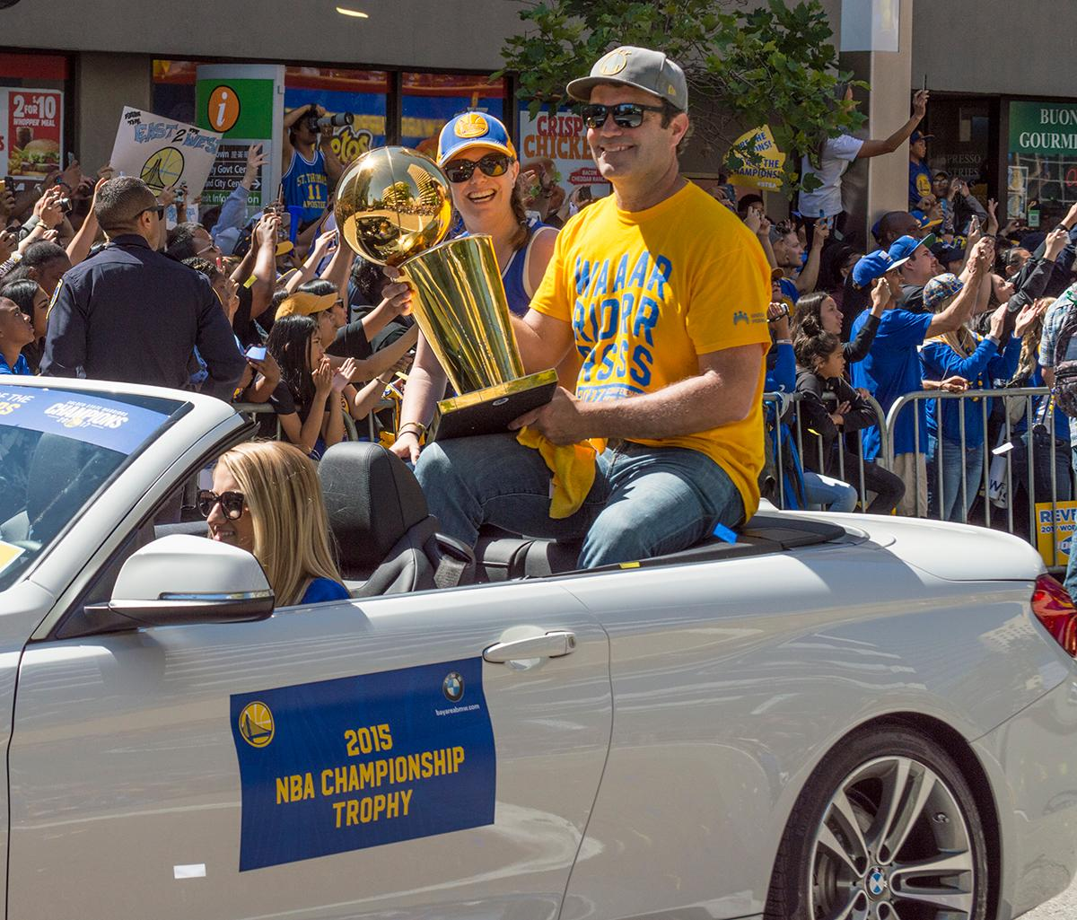 In a procession of all five NBA Championship trophies earned by the Golden State Warriors, the 2015 trophy follows. Photo by Emily Gonzalez, Oregon News Lab.