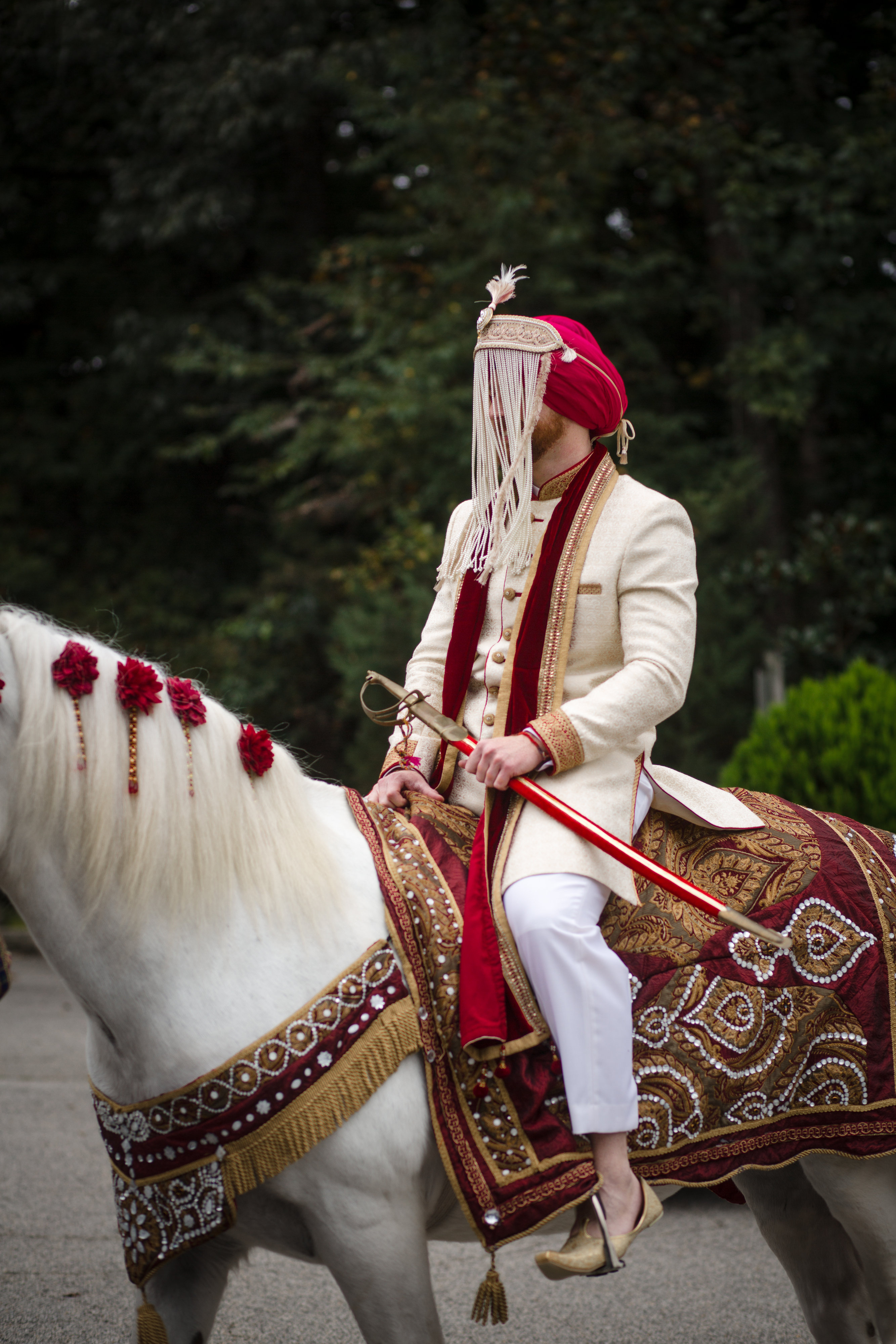 The Baraat symbolizes the official entrance of the groom. (Image: Laura Bryan Photography){ }