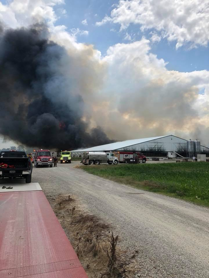 Several fire departments are battling a massive blaze at a farm that killed thousands of pigs in Fayette County. (Courtesy: Fayette County Sheriff's Office)