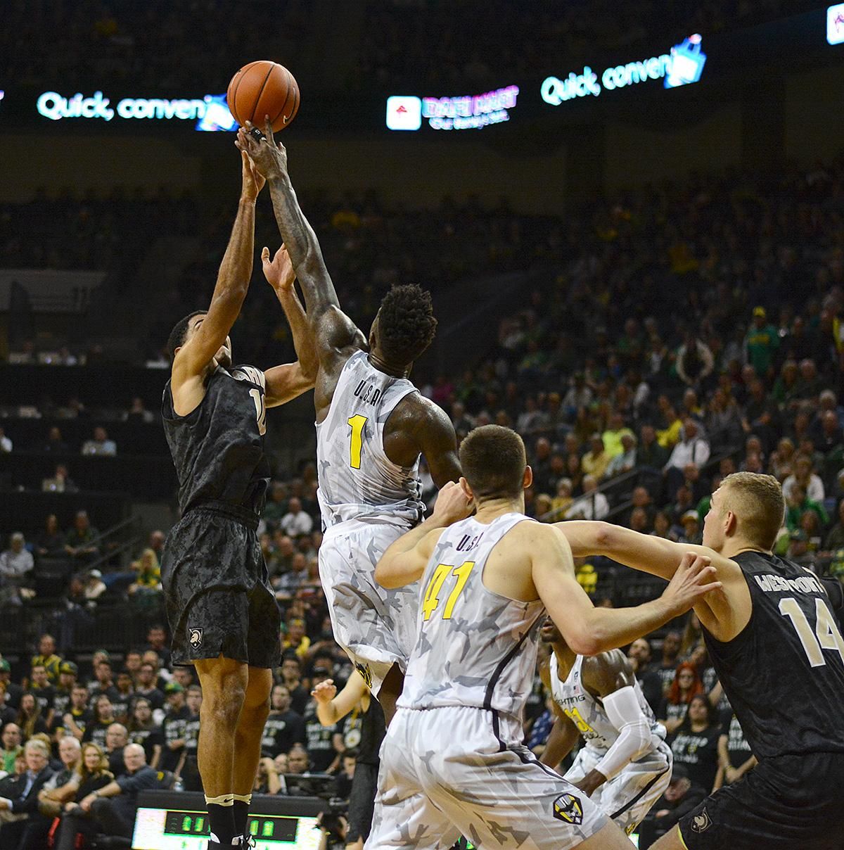 Ducks' Jordan Bell (#1) comes up with a huge block against Army's Kennedy Edwards' (#10) shot. In front of a sold out crowd, Oregon defeated Army 91-77 on opening night. Photo by Jacob Smith, Oregon News Lab
