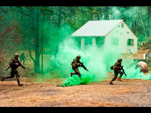 U.S. Marine Corps officers cross a danger area during urban operations training at The Basic School on Marine Corps Base Quantico, Va., March 28, 2014.