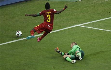 Ghana's Asamoah Gyan, left, leaps as he runs past Germany's goalkeeper Manuel Neuer during the group G World Cup soccer match between Germany and Ghana at the Arena Castelao in Fortaleza, Brazil, Saturday, June 21, 2014.