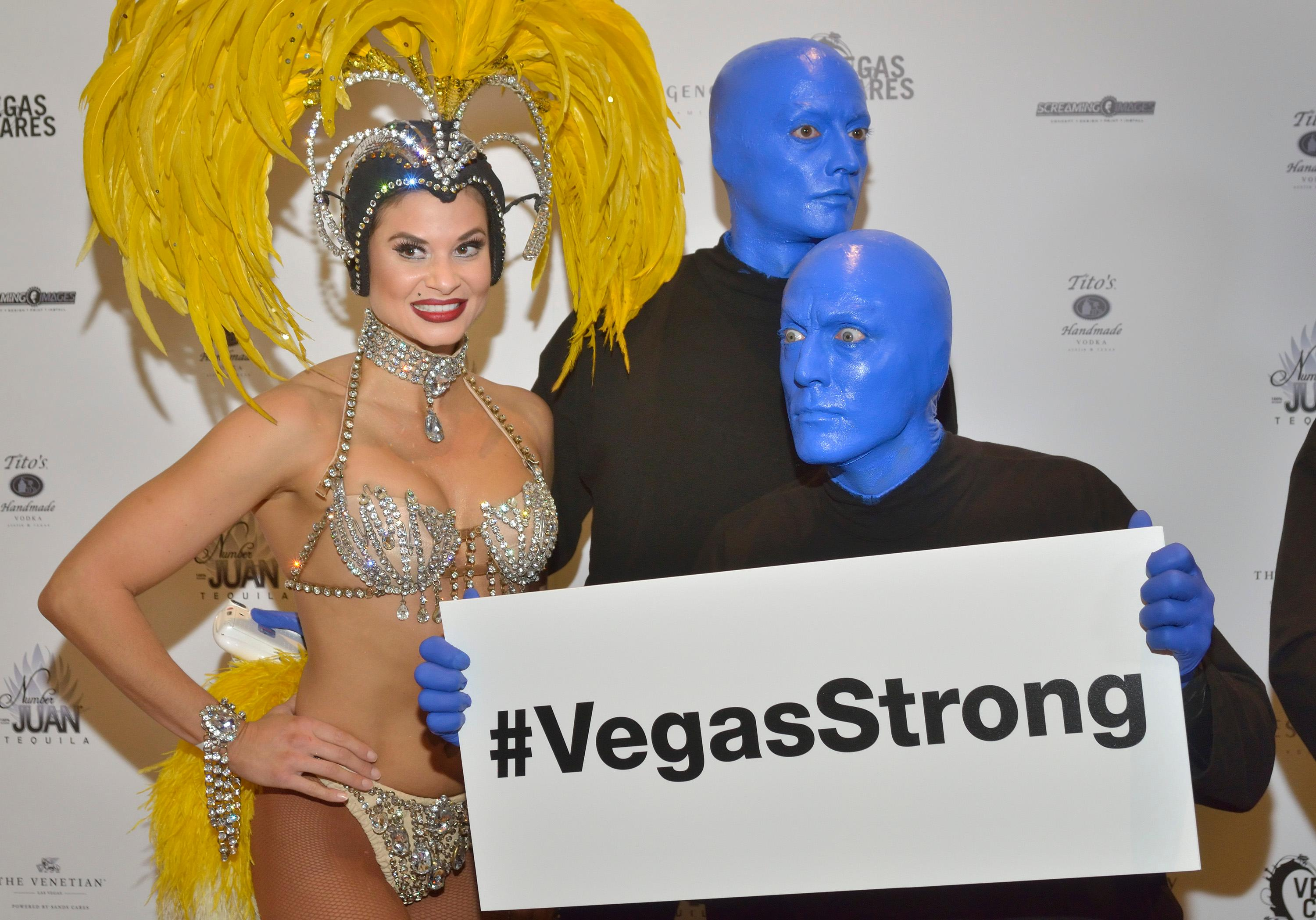 "Showgirl Dani Flahuie is shown with members of the Blue Man Group at the ""Vegas Cares"" benefit concert at the Venetian Theatre in the Venetian hotel-casino at 3355 S. Las Vegas Blvd in Las Vegas on Sunday, Nov 5, 2017. The concert was sponsored by a group of Las Vegas entertainers, producers and business professionals to honor the victims and first responders from shooting at the Route 91 Harvest festival. (Photo/Las Vegas News Bureau/Bill Hughes)"