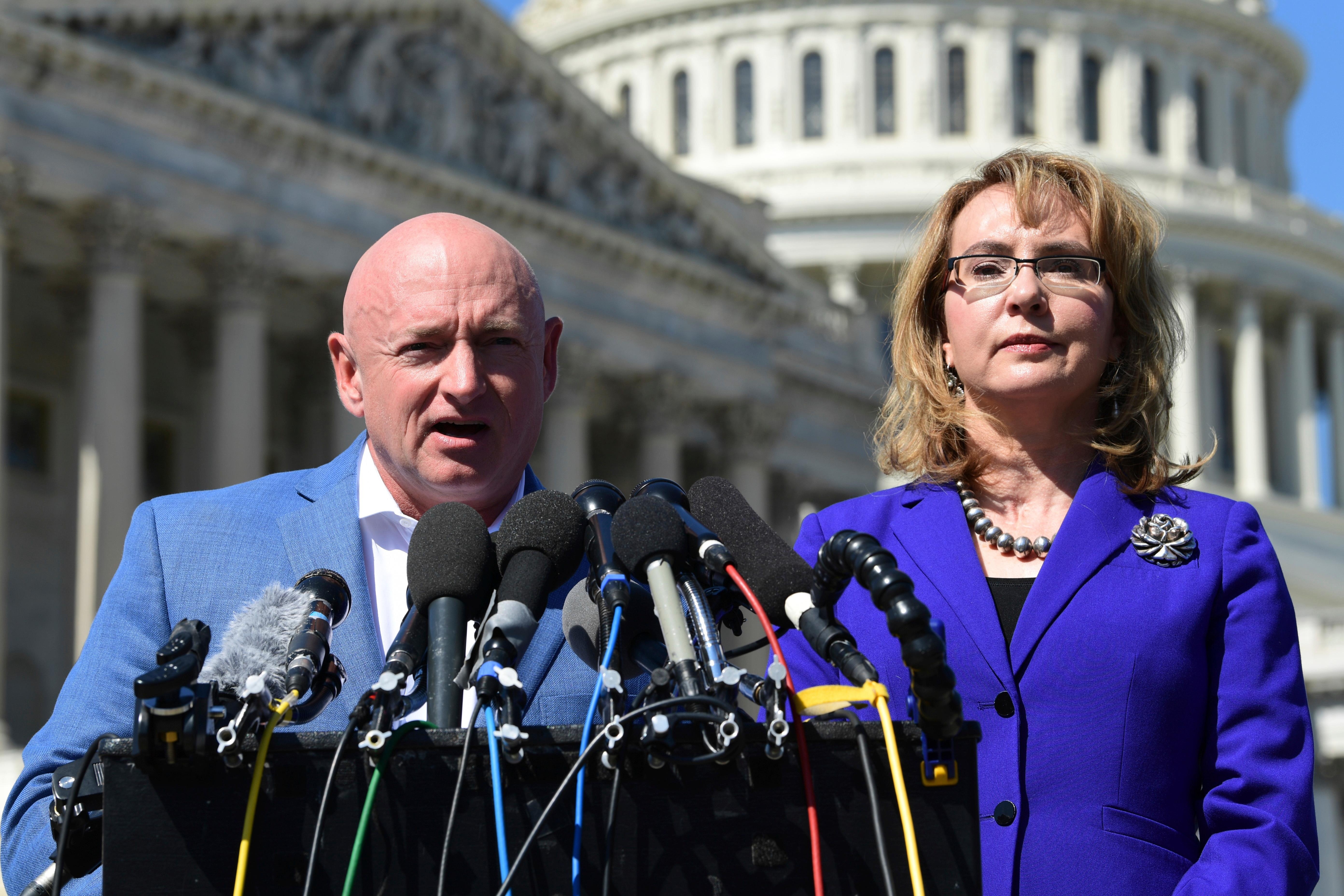 Former Rep. Gabrielle Giffords, D-Ariz., right, listens as her husband Mark Kelly, left, speaks on Capitol Hill in Washington, Monday, Oct. 2, 2017, about the mass shooting in Las Vegas. Giffords, was a congresswoman when she was shot in an assassination attempt in 2011. (AP Photo/Susan Walsh)