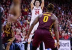 Wisconsin's Bronson Koenig (24) shoots against Minnesota's Dupree McBrayer (1) and Akeem Springs during the second half of a game Sunday, March 5, 2017, in Madison.