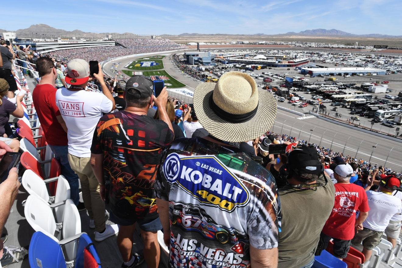 Fans stand for the start of the Monster Energy NASCAR Cup Series Kobalt 400 Sunday, March 12, 2017, at the Las Vegas Motor Speedway. (Sam Morris/Las Vegas News Bureau)