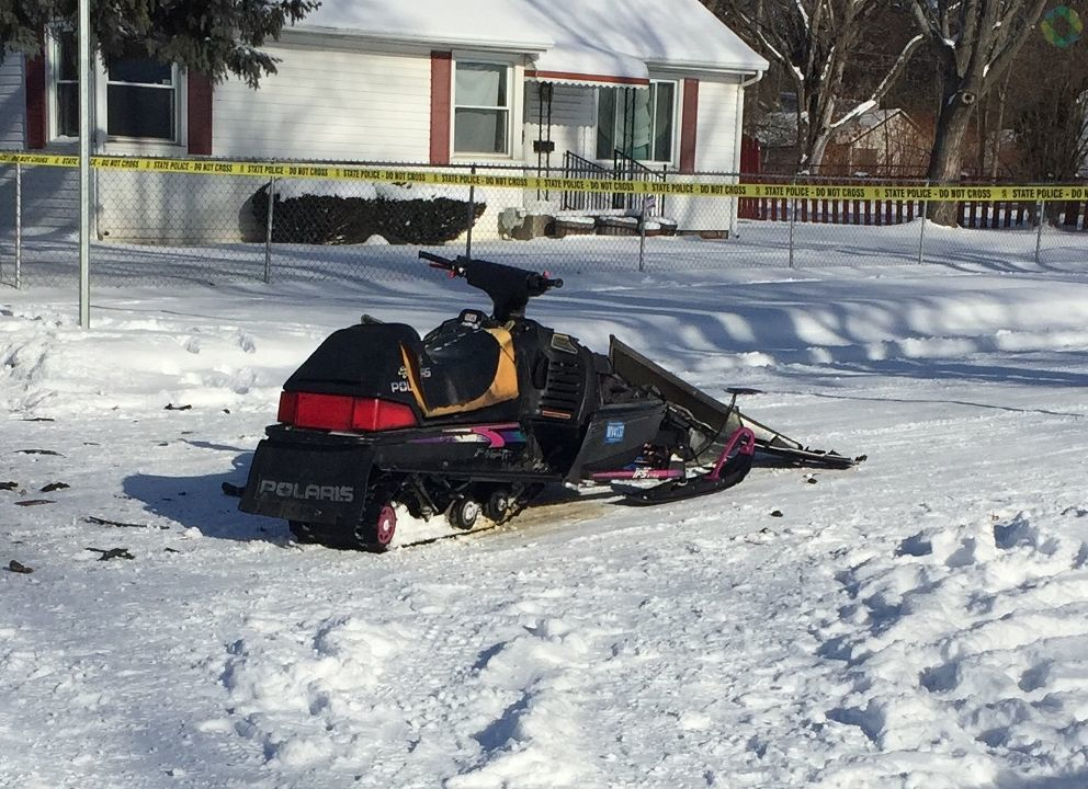 Flint Police are investigating a car vs snowmobile crash in Flint on the corner of Woodrow and Curry Street. Man driving snowmobile in critical condition. (Photo: WEYI/WSMH)