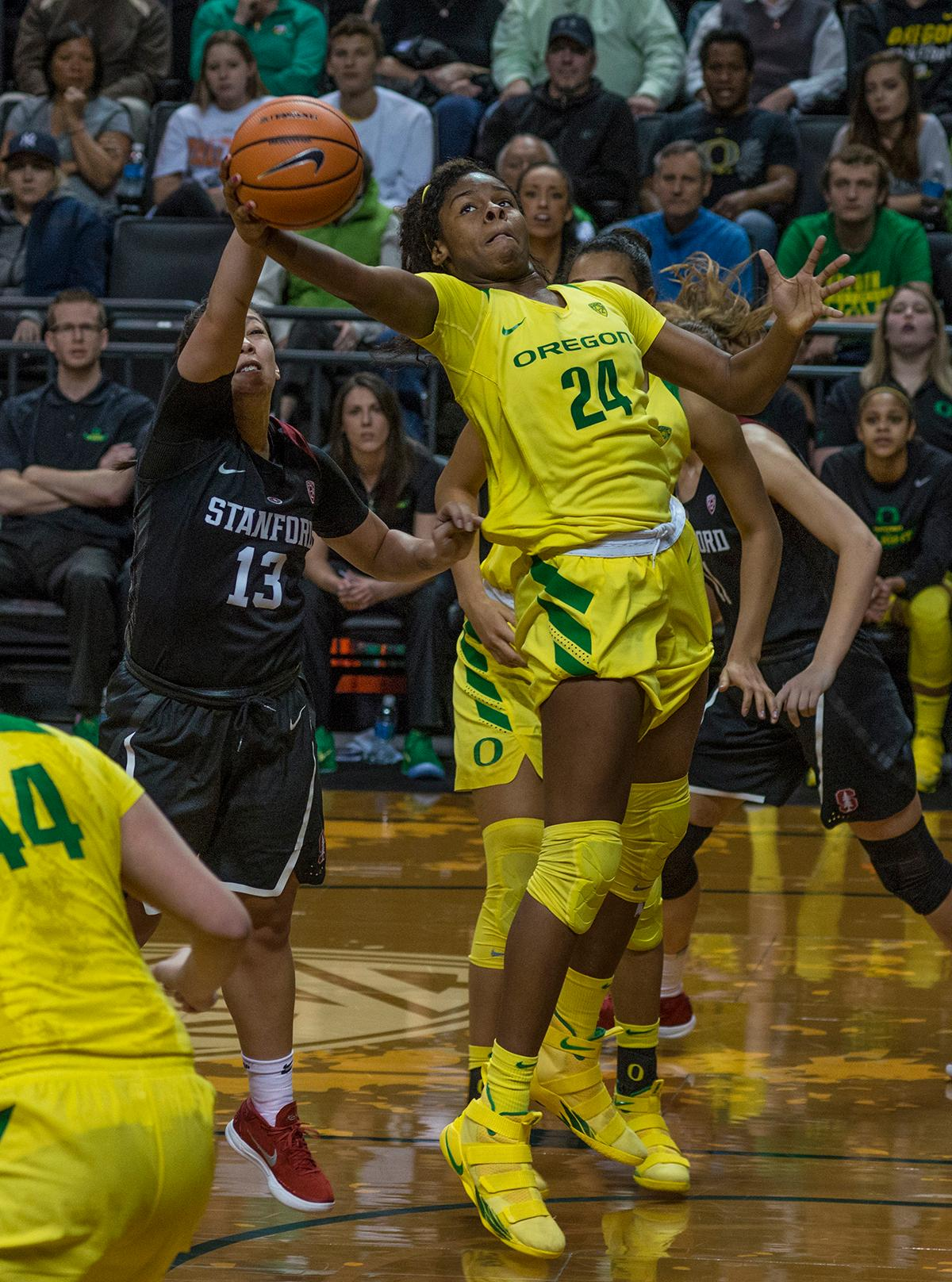 Stanford Cardinal Marta Sniezek (#13) tussles with Oregon Ducks Ruthy Hebard (#24) for control of a rebound. The Stanford Cardinal defeated the Oregon Ducks 78-65 on Sunday afternoon at Matthew Knight Arena. Stanford is now 10-2 in conference play and with this loss the Ducks drop to 10-2. Leading the Stanford Cardinal was Brittany McPhee with 33 points, Alanna Smith with 14 points, and Kiana Williams with 14 points. For the Ducks Sabrina Ionescu led with 22 points, Ruthy Hebard added 16 points, and Satou Sabally put in 14 points. Photo by Dan Morrison, Oregon News Lab