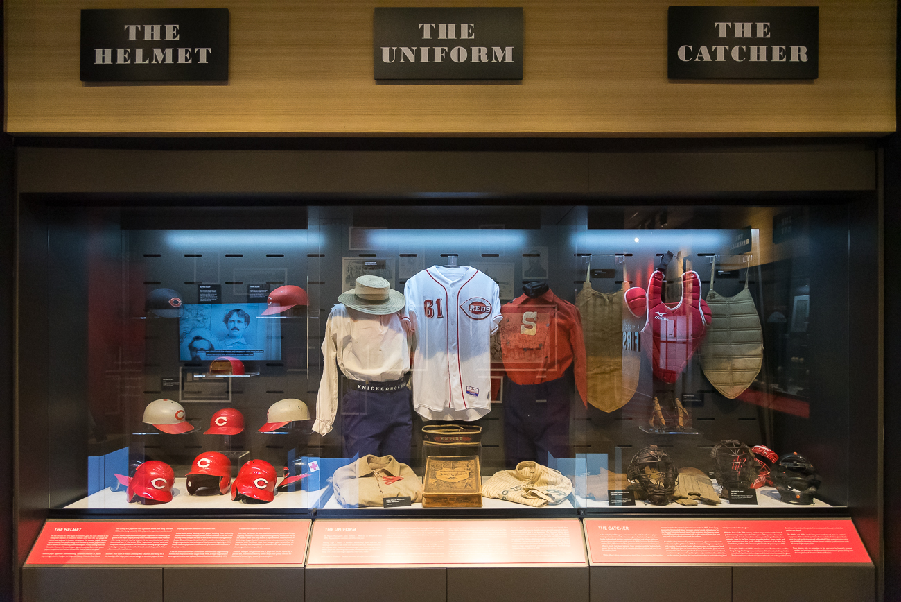 Authentic pieces of Reds history, such as game schedules and tickets from various years, are on display in sealed, glass cases. / Image: Phil Armstrong, Cincinnati Refined // Published: 4.20.19