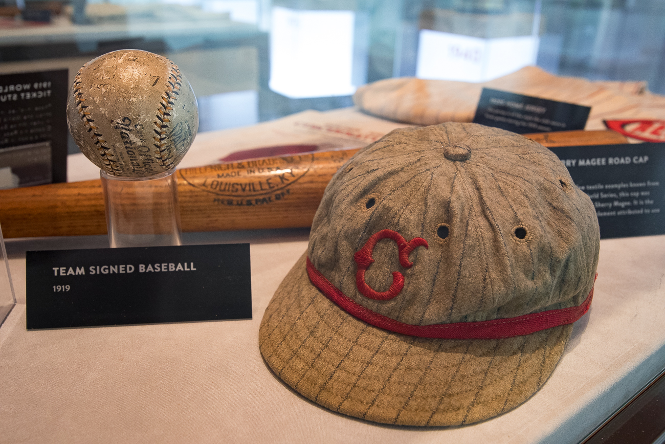 The museum is filled to the brim with artifacts from Reds—and Cincinnati—history. A display of baseballs ranging from the 1840s to present day can be seen in one section of the museum. Crosley Field's chairs, pieces from Riverfront Stadium, and other Reds relics can be found throughout. Old catcher's mitts, baseball bats, face masks, uniforms, hats, jerseys, shoes, and other essential apparel are on display as well. / Image: Phil Armstrong, Cincinnati Refined // Published: 4.20.19