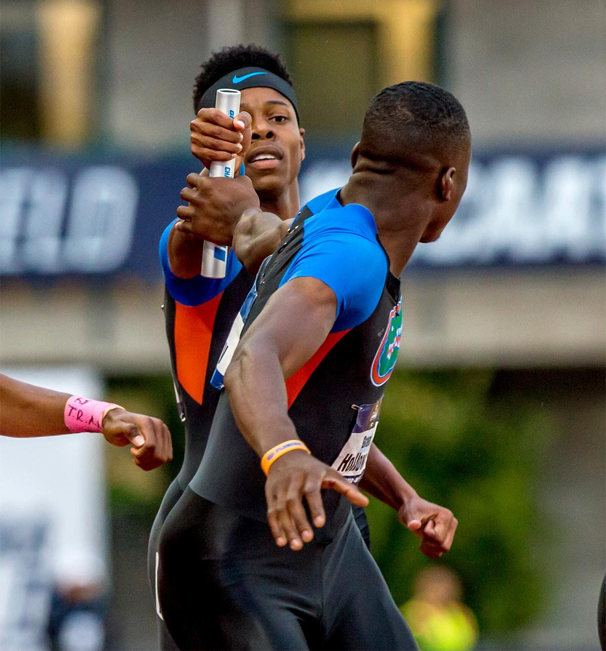 Florida's TJ Holmes hands the baton off to his teammate Grant Holloway. Florida would place third overall in the semi-finals with a time of 3:03.38. Photo by August Frank, Oregon News Lab