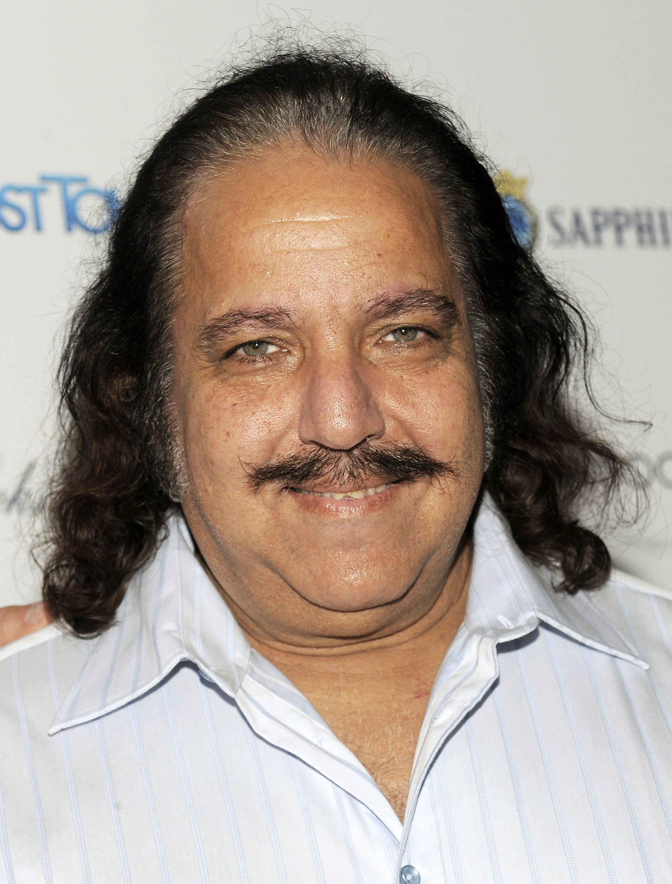 "FILE - In this Sept. 15, 2008 file photo, adult film star Ron Jeremy attends a Cinema Society screening of ""Ghost Town"" in New York. Jeremy has been charged with raping three women and sexually assaulting a fourth. (AP Photo/Evan Agostini, File)"