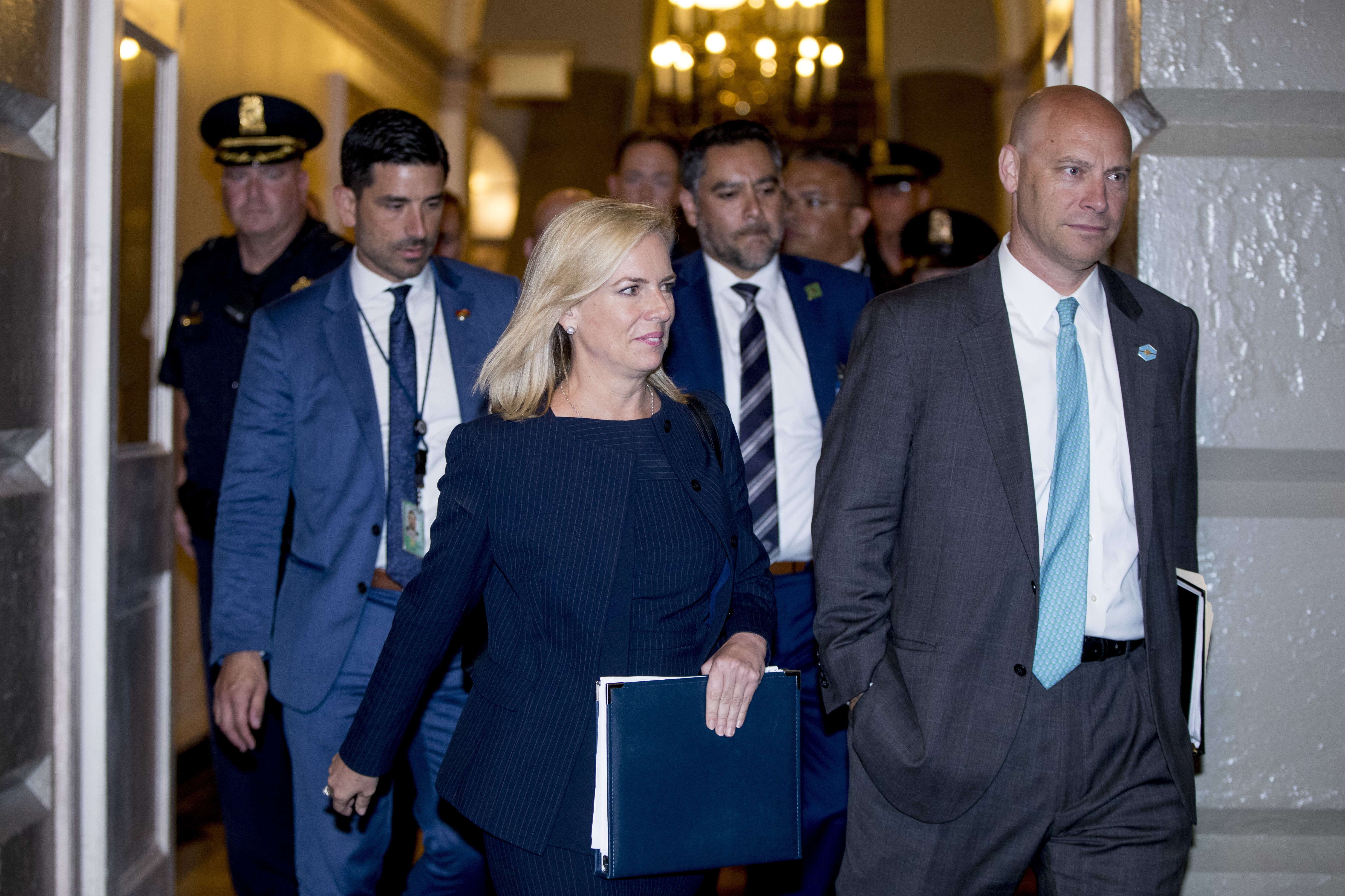 Homeland Security Secretary Kirstjen Nielsen, left, and White House Director of Legislative Affairs Marc Short, right, arrive for a meeting with President Donald Trump on Capitol Hill in Washington, Tuesday, June 19, 2018, as Trump rallies Republicans around a GOP immigration bill.  (AP Photo/J. Scott Applewhite)
