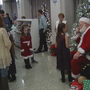 Santa has breakfast with kids at the Sugarplum Festival of Trees