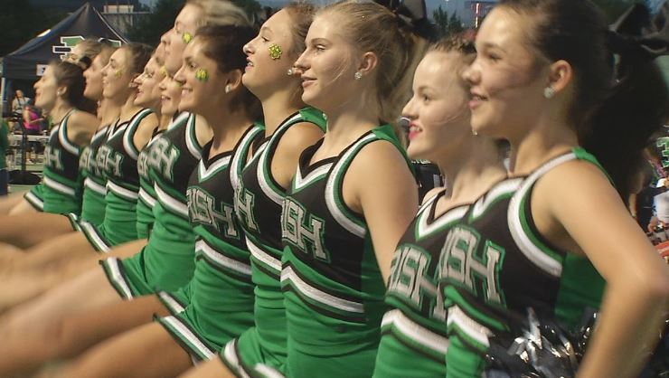 The Bishop McGuinness Cheerleaders cheer on the Fighting Irish during the game against Enid on Friday, Sept, 15, 2017 (Anthony West / KOKH)
