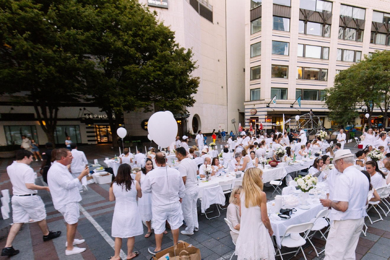 "Established nearly 30 years ago, Le Dîner en Blanc de Paris has evolved over the years, becoming a ""très chic"" tradition that now attracts over 10,000 people annually in the French Capital's most prestigious sites, with 15,000 guests attending the 25th anniversary in 2013. Today, Dîner en Blanc is held in over 70 cities in 25 countries and has gained well over 100,000 new friends worldwide. Each event is headed by passionate local organizers who fell in love with the concept and who wanted to bring it to their city, adding their own local flair while respecting the event's core values. Along with Paris, New York, Los Angeles, Tokyo, Montreal, Sydney, Singapore, Mexico City, Seattle proudly hosted its first Dîner en Blanc this year at Westlake Park! (Image: Joshua Lewis / Seattle Refined)"